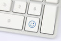 Social media key button on a keyboard showing the smile icon Stock Photos