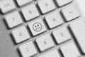 Social media key button on a keyboard showing the unhappy icon Royalty Free Stock Images