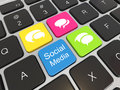 Social media on laptop keyboard. Stock Image