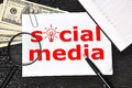 Social media paper with and money in the office Royalty Free Stock Photos