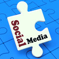 Social media puzzle shows online community relation showing Stock Photos