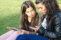 Social media young girls having fun sharing information on Stock Image