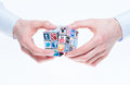 Social networking concept a hands holding rubiks cube with logotypes of well known media brands Stock Photo