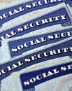 Social security cards representing retirement closeup detail of several finances and Royalty Free Stock Photography