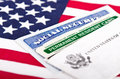 Social security and permanent resident card united states of america green with us flag on the background immigration concept Royalty Free Stock Photos