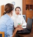 Social worker women senior answer questions of at home Stock Photos