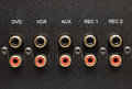 Sockets of various inputs on an black metal panel. Royalty Free Stock Photo