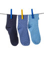 Socks hanging clothesline Stock Photo
