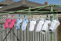 Socks hanging outside to dry Royalty Free Stock Photos