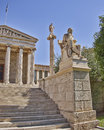 Socrates the philosopher and apollo the god of arts in front national university athens greece Stock Photography
