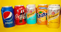 Soda cans collection isolated in yellow background Royalty Free Stock Photo