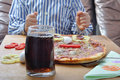 Soda and pizza on table and child Royalty Free Stock Image