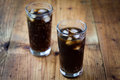 Soda whit ice glass cubes on wooden table Stock Photo