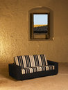 Sofa in a big empty interior with open window vertical Stock Images
