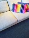 Sofa with bright rainbow striped cushions Royalty Free Stock Photo