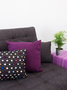Sofa with colorful cushions and green plant decorated on side table Stock Photos