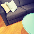 Sofa with cushions and green coffee table Royalty Free Stock Photo