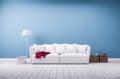 Sofa and floor lamp at blue wall