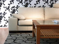 Sofa and Flower Wall Paper Stock Photos