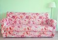 The sofa and lamp for living room in a floral pattern Stock Photos