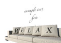 Sofa with relax text Royalty Free Stock Photos