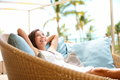 Sofa woman relaxing enjoying luxury lifestyle outdoor day dreaming and thinking looking happy up smiling cheerful beautiful young Stock Images