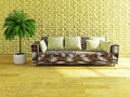 Sofa with yellow pillows near the brick wall Stock Photography