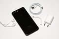 SOFIA, BULGARIA - OCTOBER 8, 2016: New Apple iPhone 7 Plus Jet Black unboxing, back side, on white background, illustrative editor Royalty Free Stock Photo