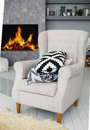 Soft armchair near the fireplace