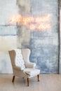 Soft armchair near the plaster wall