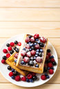Soft Belgian waffles with blueberry, raspberry, blackcurrant and Royalty Free Stock Photo