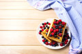 Soft Belgian waffles with blueberry, raspberry and blackcurrant Royalty Free Stock Photo