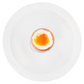 Soft boiled egg in egg cup on white plate top view of isolated Stock Image