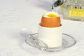Soft boiled egg in a holder on a plate Royalty Free Stock Image