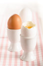 Soft boiled eggs egg cups Royalty Free Stock Images