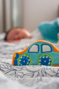 Soft car toy with sleeping baby Royalty Free Stock Photos