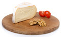 Soft cheese on a wooden board isolated white Stock Image