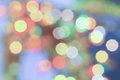 Soft colored Christmas bokeh light abstract holiday background. Royalty Free Stock Photo