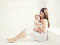 Soft comfort photo young mother with baby at home in white room Royalty Free Stock Photo