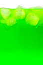 Soft drink green with ice and bubbles Royalty Free Stock Images