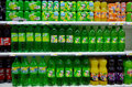 Soft drinks for sale selection of brand named stacked on shelves in a supermarket Royalty Free Stock Photos
