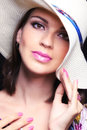 Soft focus face of a beautiful woman in a straw hat close up Stock Photo