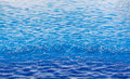 Soft focus water drop in swimming pool Royalty Free Stock Photo