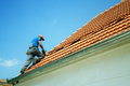 Soft focus of worker on the roof shallow depth field front roofer drilling Royalty Free Stock Photography