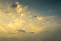 Soft gentle sky and light cloud pattern at sunset sunrise with yellow glow blue Stock Photography