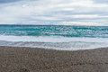 Soft and gentle waves foam in blue ocean italy coast, summer eve Royalty Free Stock Photo