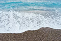 Soft gentle waves with foam in blue ocean italy coast, summer va Royalty Free Stock Photo