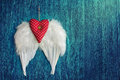 Soft red heart with white wings valentines day background Stock Photography