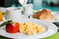Soft scrambled eggs with tomato cheese breakfast Royalty Free Stock Photography