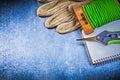 Soft twist tie garden pruner protective gloves workbook on metal metallic background Royalty Free Stock Images